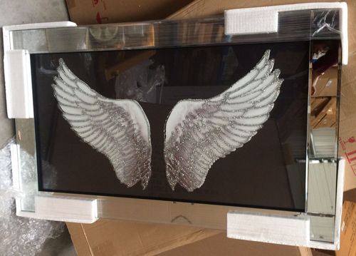 Angel wings on mirrored frame